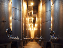 Row of steel cisterns for wine storage. In a modern winery stock images