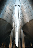 Row of steel cisterns for wine storage. In a modern winery stock photo