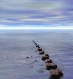 Row of Stepping Stones to Ocean Sea Horizon. Row of Stepping Stones to Distant Ocean Sea Horizon Stock Photo