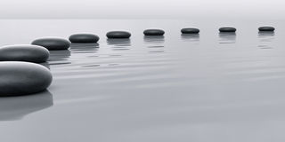 Row of stones leading. To the horizont with water surface Stock Image