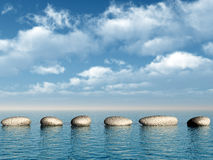 A row of stones in water royalty free stock photo