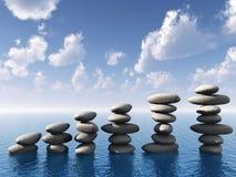 Row of stones in water stock photos