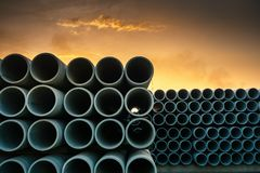Row of Storage Sewage Drainage Concrete Pipeline, Manufacturing Plant of Material Construction, Stack of Culvert Pipe and Water. Treatment System royalty free stock photography