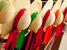 Row of straw hats with ribbons Royalty Free Stock Image