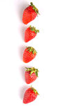 Row Of Strawberries Fruits III. Row of strawberry fruits over white background Royalty Free Stock Image