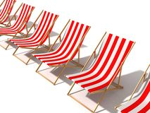 Row of striped red beach chairs on white Stock Images