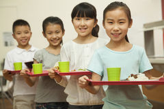 Row of students standing in line in school cafeteria Royalty Free Stock Photos