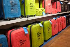 Row of suitcases on display inside a store. Row of blue,yellow and red suitcase arranged in a row inside a store Royalty Free Stock Photo