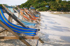 Row of sun beds in the beach of Nang Yuan Stock Photo