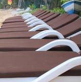 Row of sun loungers on a beach Stock Image