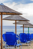 Row of sunbed at the beach and sea. Close Royalty Free Stock Images