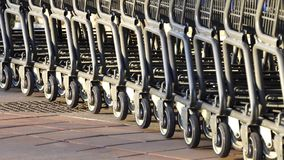 Row of supermarket shopping cart trolleys Royalty Free Stock Image