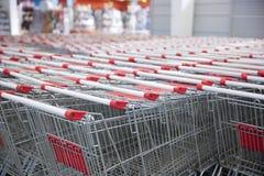 Row of supermarket trolleys. Shopping Royalty Free Stock Photos