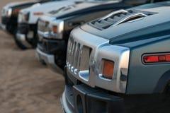 Row of SUV in desert Stock Image