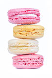 Row of sweet and colorful french macaroons dessert on white back Stock Photography