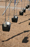 Row of swings Royalty Free Stock Photo