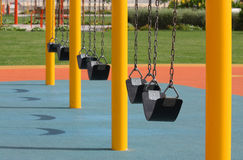 A row of swings in park near a sea side, Bahrain Stock Images