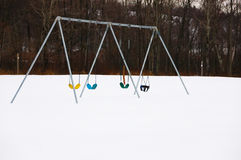 Row of Swings on a Winter Day Royalty Free Stock Photography
