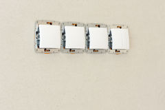 Row of switches in a wall Royalty Free Stock Image