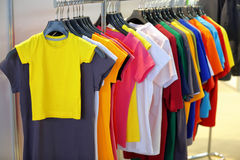 Row of t-shirts in store with empty space for text Stock Images