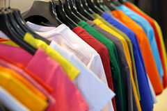 Row of t-shirts in wardrobe or store Royalty Free Stock Image