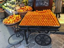 Row of tangerines in a barrow. On the market Stock Photo