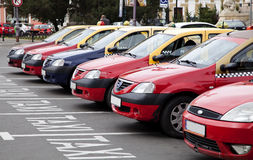 Row of taxi. Taxi drivers waiting for they clients in a taxi station in Oradea town royalty free stock photo
