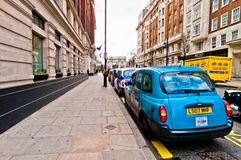 Row of taxis in front of Marble Arch, London, UK. LONDON - APRIL 15: row of taxis in front of Marble Arch, on April 15,2013 in London, UK. Motorised hackney cabs Stock Photo