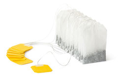Row of teabags with yellow label Stock Photography