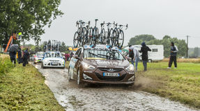 Row of Technical Cars on a Cobbled Road - Tour de France 2014. Ennevelin, France - July 09,2014:Row of technical cars driving on a cobbled road during the stage Royalty Free Stock Photos