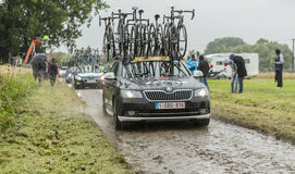 Row of Technical Cars on a Cobblestone Road - Tour de France 201 Stock Photo