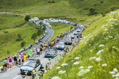 Row of Technical Cars in Pyrenees Mountains - Tour de France 201. Col de Peyresourde,France- July 23, 2014: Row of technical cars climbing the road to Col de Royalty Free Stock Image