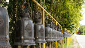Row of temple bells in thailand Stock Photos