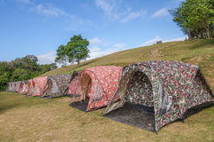 Row of tent on hill Stock Image