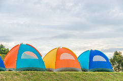 Row of tent on hill Stock Images