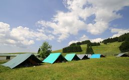 Row of tents in the summer camp of the boyscout Stock Photo