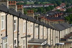 Row of Terraced Houses with Red Chimney Pots Stock Photo