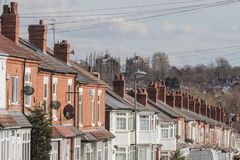Row of terraced houses. Row of terraced house roofs with chimney stacks royalty free stock images