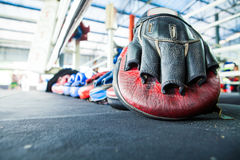 Row of thai Boxing Mitt Training Target Focus Punch Pad Glove on Royalty Free Stock Photography