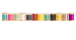 Row of thread spools isolated Stock Photo