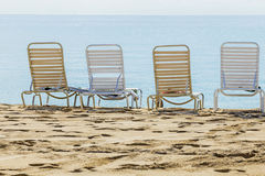 A row of three beach chairs Royalty Free Stock Image