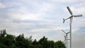A Row of Three Blades Wind Turbines Stock Photos