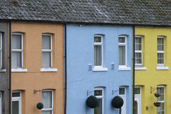 Row of three brightly coloured houses Stock Photos