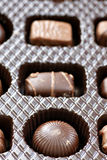 Row of three delicious chocolates. Inside a box of chocolates, row of three, differents shapes and taste Stock Images