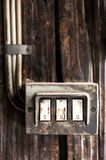 Row of three grungy electrical switches Royalty Free Stock Images
