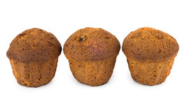 Row of three muffins  on white Royalty Free Stock Image