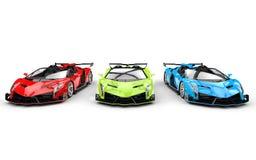 Row of three race supercars Stock Photos