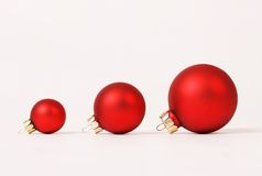 Row of three red matt different sizes christmas balls Stock Photography