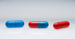 Row of three variegated pills Royalty Free Stock Images