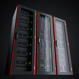 Row of three working server racks isolated on black background Royalty Free Stock Photography